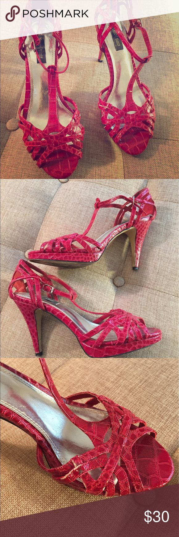 White House Black Market red strappy high heels Beautiful and fun shoes.  Lightly worn with a couple small scuff marks (hardly noticeable).  4 inch heel, leather red snake skin print. White House Black Market Shoes Heels