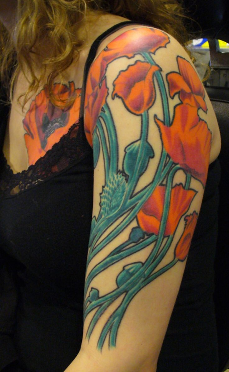 I did not do this tattoo. Its a decent example of Mucha's style zoomed in and simplified. I kind of wish it had thicker lines. It has great flow though, I like the placement.