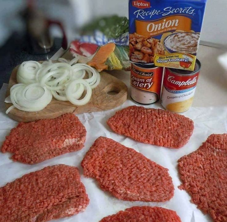 Ingredients: 6 cube steaks 1 medium onion peeled and sliced into rings 1 can cream of chicken soup 1 can cream of celery soup 1 packet Lipton Onion Soup Mix 1/2 soup can of water salt and pepper Instructions: Peel, slice and separate the