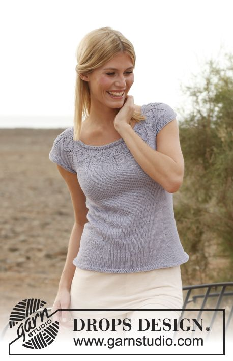 "Knitted DROPS top with round yoke and lace pattern in ""Muskat"". Size: S - XXXL"