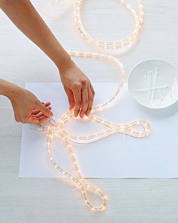 DIY outdoor snowflakes with rope lights via Martha Stewart.