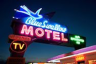 Blue Swallow neon still guides Route 66 travelers.