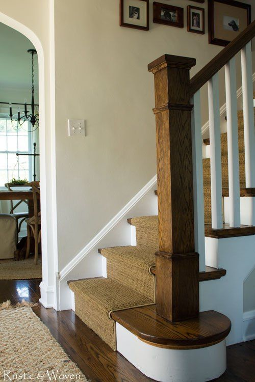 Wood-stairs-with-white-risers-and-carpet-runner.--Vintage-looking-newel-post.--Rustic-&-Woven