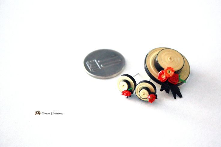 small, small earrings and a brooch