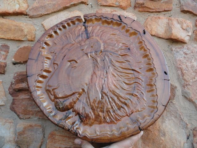 Lion Head carving on log with stand