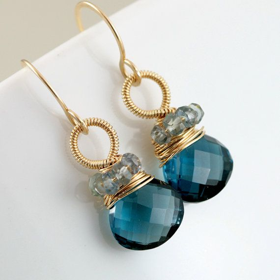 London Blue Topaz/ Aquamarine earrings... Very attractive.
