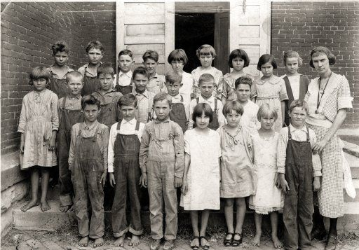 "The capture of the ""real"" farm life in Foster, Missouri in the 20's. The poor children, barefoot, with dirty clothes, impetigo on their little faces and the look of the school marm are classic to me. Farm School: 1920s"