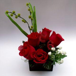 Centros de mesa para boda: Centro de mesa con rosas rojas artificiales