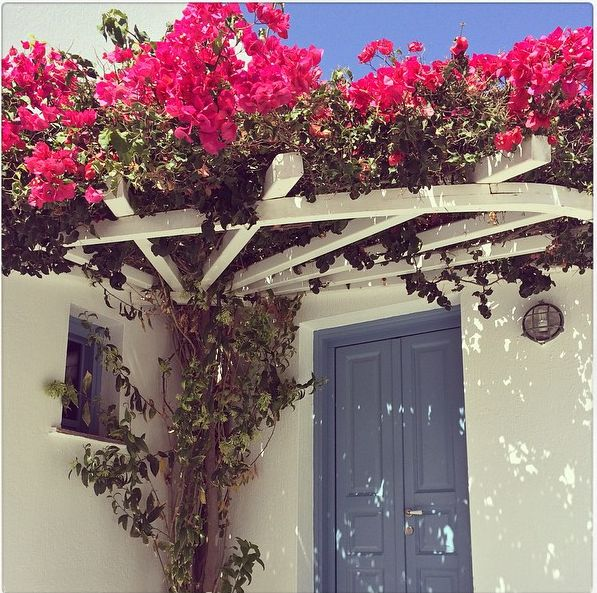 wooden door and window in Folegandros, Greece by VI.E.K.KO. S.A.