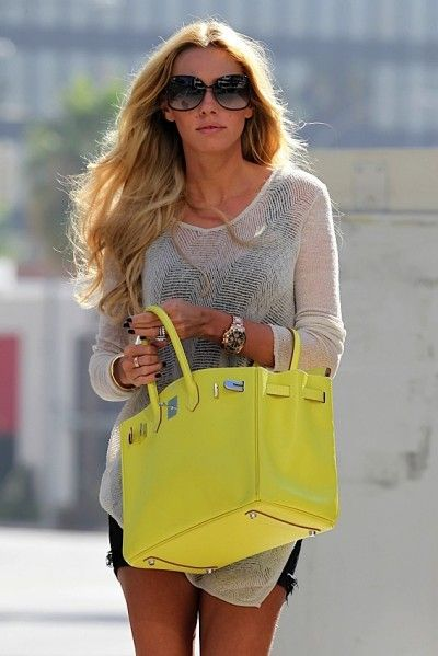 Petra Ecclestone with gorgeous hair, cute knit sweater and amazing yellow Birkin