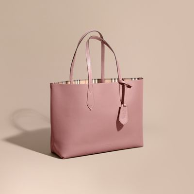 The sleek and practical Reversible Tote in signature Haymarket check and leather. Turn the bag inside out for a classic leather-bag look. Designed without pockets, it offers optimal space for your everyday essentials and more.