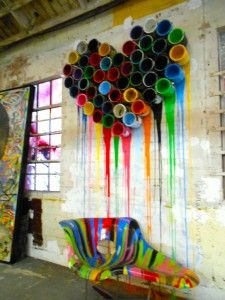 Love the dripping paint pots as wall art. Would look cool in an airy loft apartment.