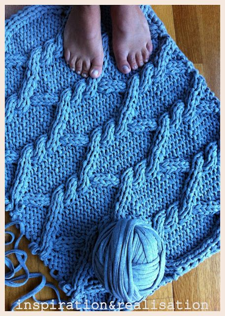 DIY giant knitted rug; Lion Brand Fettuccini yarn would be great for this.