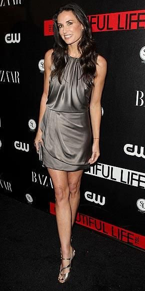 Who made Demi Moore's silver dress that she wore to the premiere of husband Ashton Kutcher's new show The Beautiful Life at the launch party in New York City? Dress – Julian McDonald