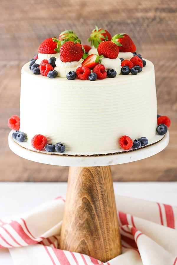Berry Mascarpone Layer Cake - layers of moist vanilla cake, fresh berry filling and whipped mascarpone frosting! | Baker by Nature