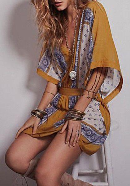 Sitting model in ethnic print short kaftan dress