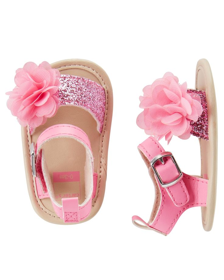 Dress up her little feet with these sweet sandal crib shoes, featuring locker loops and rosette plume detail.