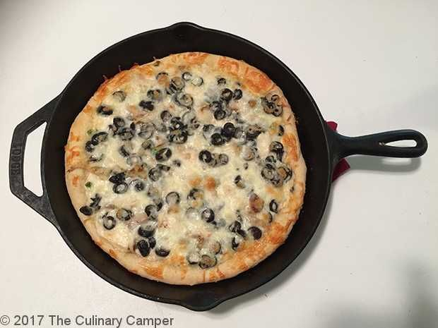 Grilled chicken spiedie pizza I made with onions and olives.