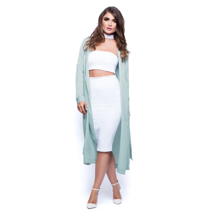 The perfect transitional piece is here with our full length duster jacket. Made from a luxuriously soft fabric, this stunning long sleeve coat features statement oversized lapels and a waist tie belt so you can wear it loose or fastened. Dress up your favourite bodycon and keep your hair loose.  Features oversized lapels, long sleeves and a self tie wast belt. Gorgeously soft luxe fabric for the most perfectly flattering fit. Full length (high shoulder to hem approx. 46\