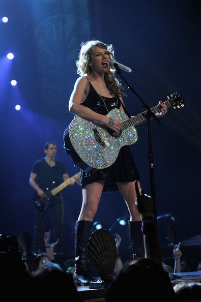 Taylor Swift wore a dazzling sequined dress with her glittering guitar on stage at the Speak Now World Tour in NYC.