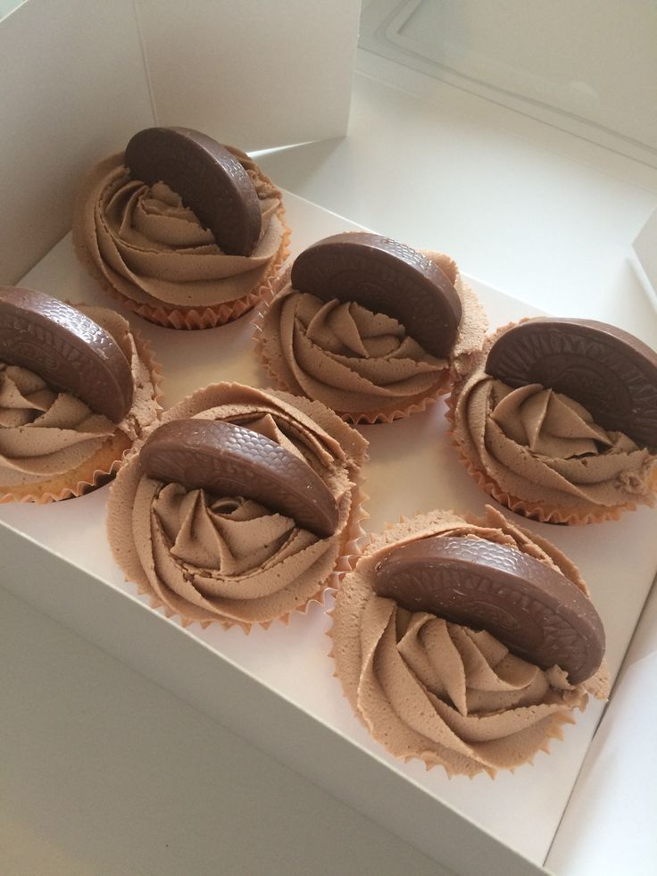 Chocolate-orange cupcakes with  a chocolate-orange mousse buttercream, topped with a wedge of Terry's chocolate orange