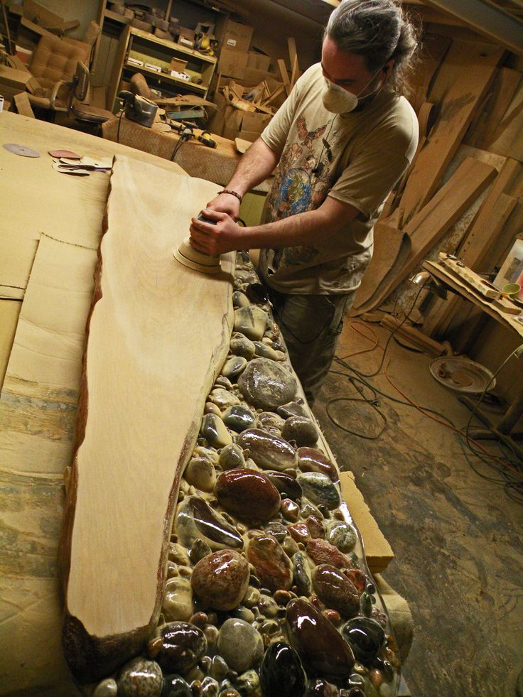 Ricky is finishing up sanding this unique Ancient Kauri table top. The rock bed within the table will stay textured as is for a natural feel. www.ancientwood.com