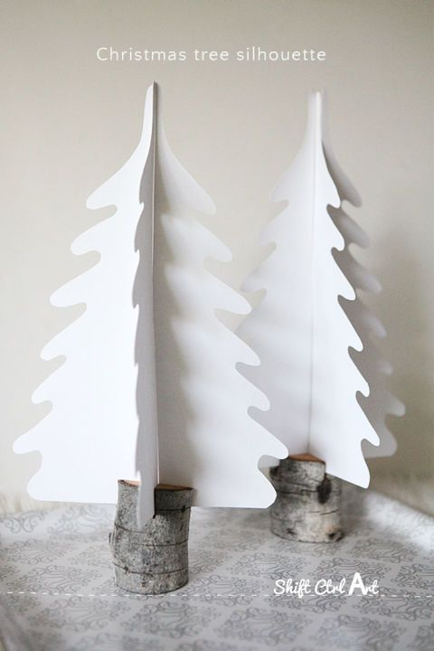 Silhouette Christmas trees: Simple but sweet, paper trees are held in real tree stumps and can be made in a flash. Find more easy, rustic, and cool DIY Christmas craft ideas that can decorate your home this Christmas here.