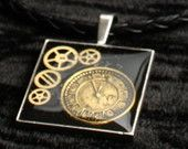 Silver Steampunk Square Frame Pendant containing Watch Gears on Black Plaited Faux Leather Necklace