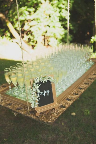 Transform a framed mirror into a swinging drink display.