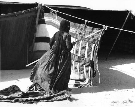 Saudi Arabia: Dorothy Miller Collection. Bedouin woman fixing her tent