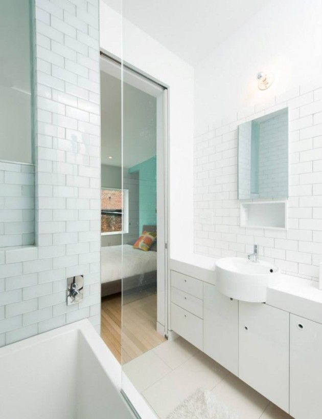 White subway tiles feature in this all white bathroom