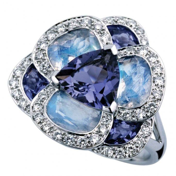 Isabelle Langlois.  Gorgeous, and since it overflows with my sapphire birthstone, wish it had been in the cards for me on my big day last week.  Dream on!  :)