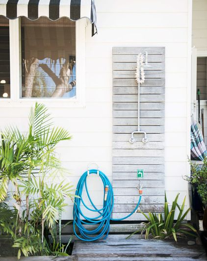An outdoor shower is a must-have if you live near the beach. If you do reside seaside, an outdoor shower is of course the hands-down best way to keep sand outdoors where it belongs. Installing a foot shower is a worthy addition — even folks who don't want to bother with a full shower can at least rinse off sandy toes before stepping into the house.