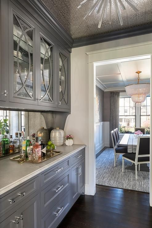 Accented With A Tin Covered Ceiling Lined With Charcoal