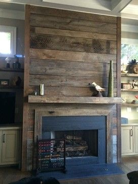 Reclaimed wood fireplace    it would be easy to cover the ugly brick with this and cheap but beautiful