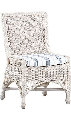 The Willowwood Road Wicker Chair wicker exudes a timeless air. The framed, diamond–patterned back, arched stretchers and knotted feet display intricate Victorian handiwork. The fabric seat cushion softens the look with navy ticking. ($249.99)