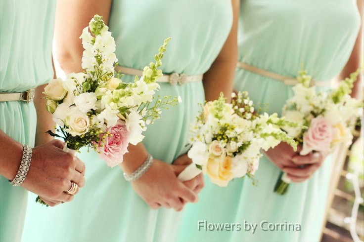 smaller bridesmaids bouquets...without the really tall flower