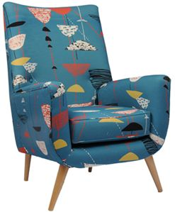 A 1950s Lucienne Day textile used to upholster a vintage chair.