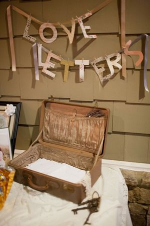 """Love Letters"", a cute way to signify wedding guests to leave a note for the couple"