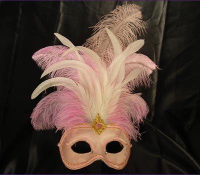 Lidia MT39 - Maschera rosa in cartapesta fatta a mano decorata con pizzi, velluti, damascati, Swarovski e piume.  Hand-made papier-mâché pink mask decorated with fabric, velvet,  brocade fabric, Swarovski and plume.