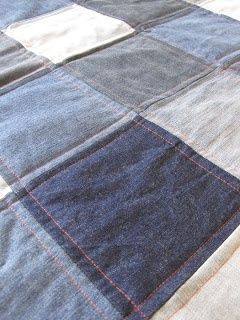 I can't decide between this moretraditional denim quilt or making a rag quilt with the fuzzy seams.I love this idea of the bright orange thread to mimic the seams ofLevi's!