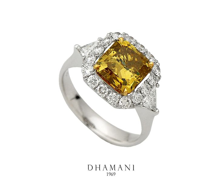 A dazzling combination of Fancy Yellow #Diamond #ring with 18k White Gold Weighing 6.35 Grams, Studded with 3.07 Carats of Natural Fancy Deep Brown Yellow Radiant cut #Diamond and 1.04 Carats of Trillion and Round #Diamonds - At Dhamani The Dubai Mall #Dhamani1969 #luxury #NaturalBrilliance #mydubai