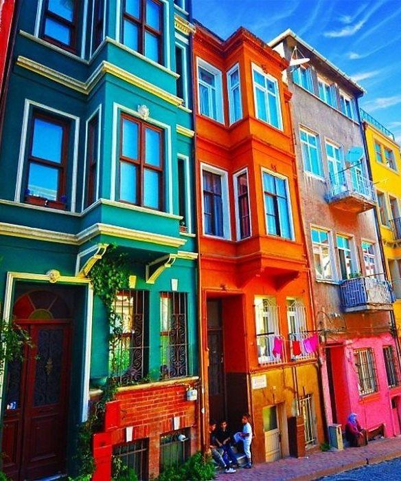 looking for color inspiration at home how much prettier are these row houses when theyre covered in bright pops of greens oranges and yellows bright colorful home