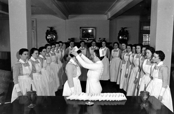 "Caption from LIFE Magazine, 1938, at New York's Roosevelt Hospital School of Nursing -""Capping"" services take place in the reception room of the Nurses' Home. The novices, having successfully passed examinations for their crucial first six months, are now permitted to wear bibbed apron, the striped uniform and the cap of the full-fledged student nurse."