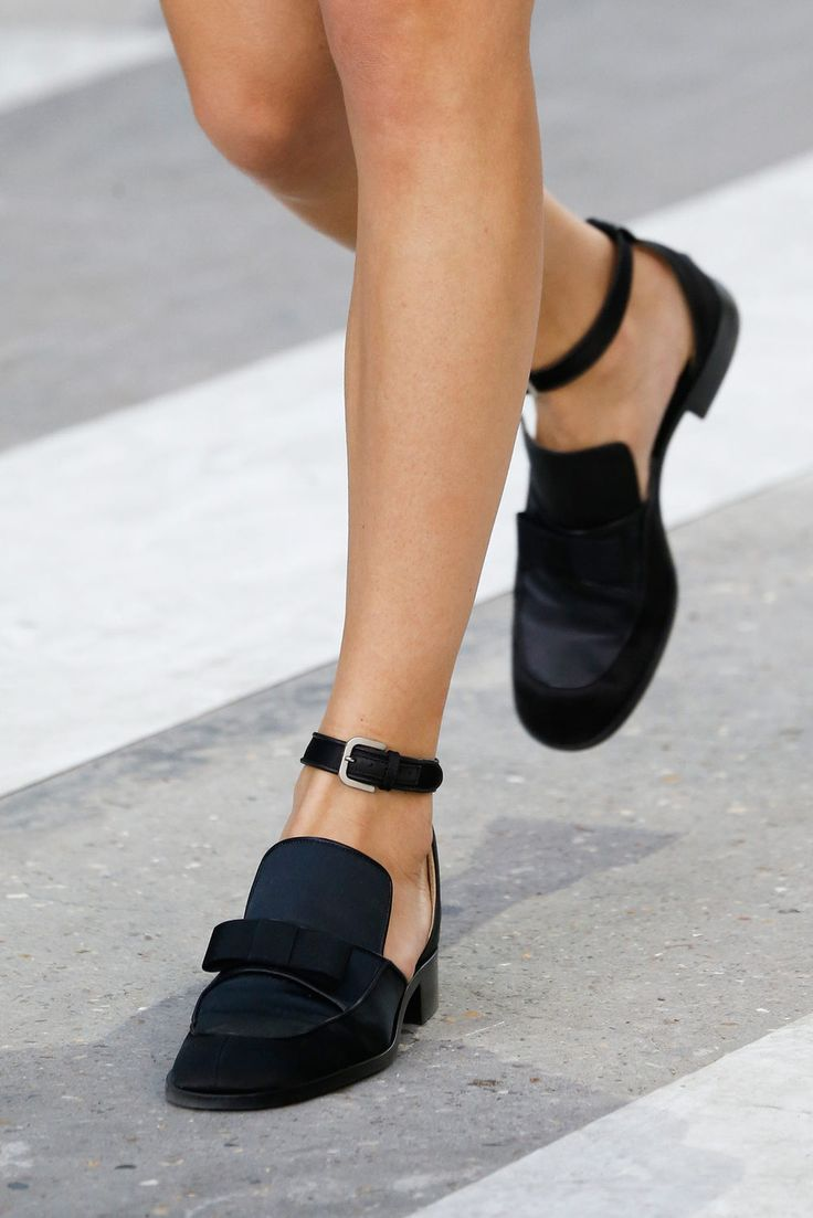Today I'm obsessing over the Chanel ankle strap shoes for Spring 2015, as  recently shown on the runway in Paris. Hands down THE best pair I've seen  all season. I love when a classic model gets a new little twist. In this  case I'm particularly liking the contrast between the heavy front with the  bow and the lightness down the back of the shoe with the ankle strap.  credit: style.com