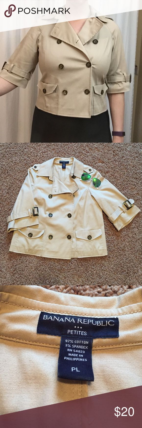 """Banana Republic safari/trench style cropped jacket So cute! Cropped safari jacket from Banana Republic complete with little buckle belted sleeves. Unlined. Jacket is 21.5"""" long. Sleeves are elbow length. Double breasted with cute tortoise shell buttons. Bust 20"""" from armpit to armpit. Nice stretch to fabric. Please note this is a petite! Banana Republic Jackets & Coats Blazers"""