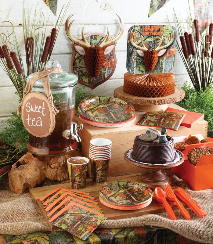 My Paper Shop.com - Hunting party supplies and decorations showcase a woodsy forest scene with tree trunks, branches, and autumn leaves in rich, earth tone colors. This outdoor sports themed design is printed on bulk paper napkins, party plates, paper beverage cups, plastic banquet tablecloths and party invitations. Add the finishing touches to your event setting with coordinating honeycomb table centerpieces, wall cutouts, metallic party balloons, jointed and flag banners, and plastic loot…