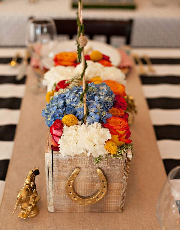 Kentucky Derby Garden Party theme... This would go along great with our (freshly stained) horse stables! The flowers are perfectly summery and vibrant