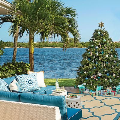 Position your tree in a spot where it can be admired indoors and out. If the weather isn't too chilly, like here in West Palm Beach, Florida, you can take your holiday party outside and still maintain a festive atmosphere.