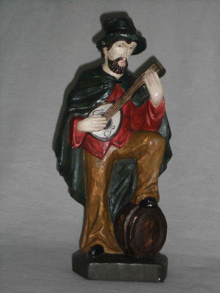 Der Musiker alte handgeschnitzte Holzfigur